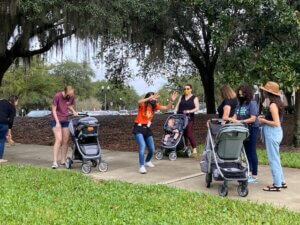 Teaching Artist performs for babies in strollers.
